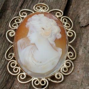 Vintage carved cameo brooch